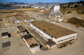 "Aerial photos of Hunters Point Naval Shipyard Building 401 in Parcel G in San Francisco, Calif., on Tuesday, September 11, 2018. The Navy's retesting plan for Parcel G is being brought into question. When the U.S. Navy pledged to perform new soil tests at its Superfund waste site in San Francisco, the priority was ""to protect the human health and the environment."" But the Navy's re-testing plan is largely based on a cost-cutting report it paid a defense contractor to put together more than six years ago. What's more, the old report relies on data collected by Tetra Tech, the cleanup firm that submitted fake measurements and got caught. It essentially advocates for lowering cleanup standards and leaving more radioactivity in the ground.  Multiple government agencies have now come out against the Navy?s plan to re-test Parcel G, saying that it could put public health at risk if it is not changed. Environmental experts agree and say even if the Navy listens to those agencies the plan is flawed and falls far short of what was promised in the wake of the Tetra Tech fraud revelations."
