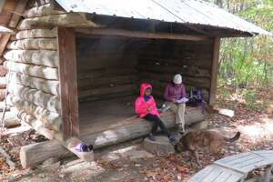 Outdoor writer Gillian Scott and her foster daughter at the lean-to in the Sanders Preserve in Glenville. (Gillian Scott/Times Union)