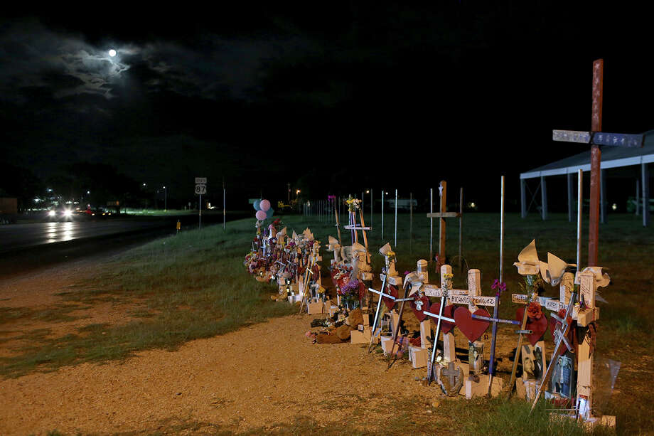 The moon rises over the memorial on the edge of the property next to the First Baptist Church. / Lisa Krantz/San Antonio Express-News