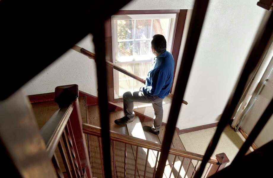 New Haven, Connecticut - Thursday, October 25, 2018:  Nelson Pinos of Ecuador, 44, one of two immigrants currently living within churches in Connecticut, says he enjoys the light coming through windows at the First and Summerfield United Methodist Church in New Haven. Photo: Peter Hvizdak, Hearst Connecticut Media / New Haven Register