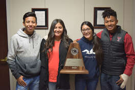 Peter Guajardo, senior, Virginia Monre, senior, Serena Lopez, junior, Attila Wynn, senior - all drum majors - hold the trophy the band received this weekend for Division I rating.