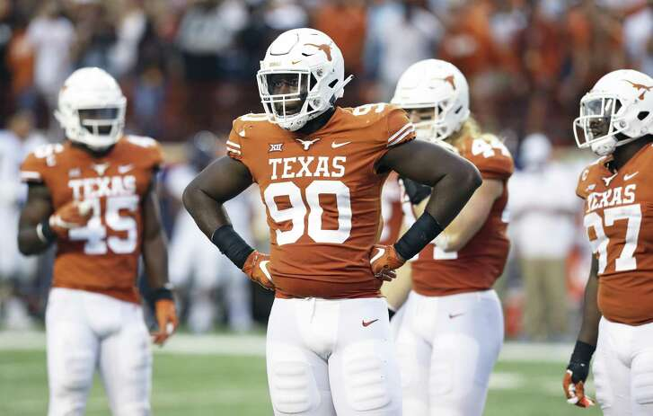 Longhorn defensive lineman Charles Omenihu takes signals from the sideline as UT hosts TCU at DKR Stadium on September 22, 2018.