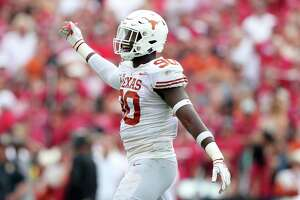 DALLAS, TX - OCTOBER 06: Charles Omenihu #90 of the Texas Longhorns celebrates after a play against the Oklahoma Sooners in the first half of the 2018 AT&T Red River Showdown at Cotton Bowl on October 6, 2018 in Dallas, Texas. (Photo by Tom Pennington/Getty Images)