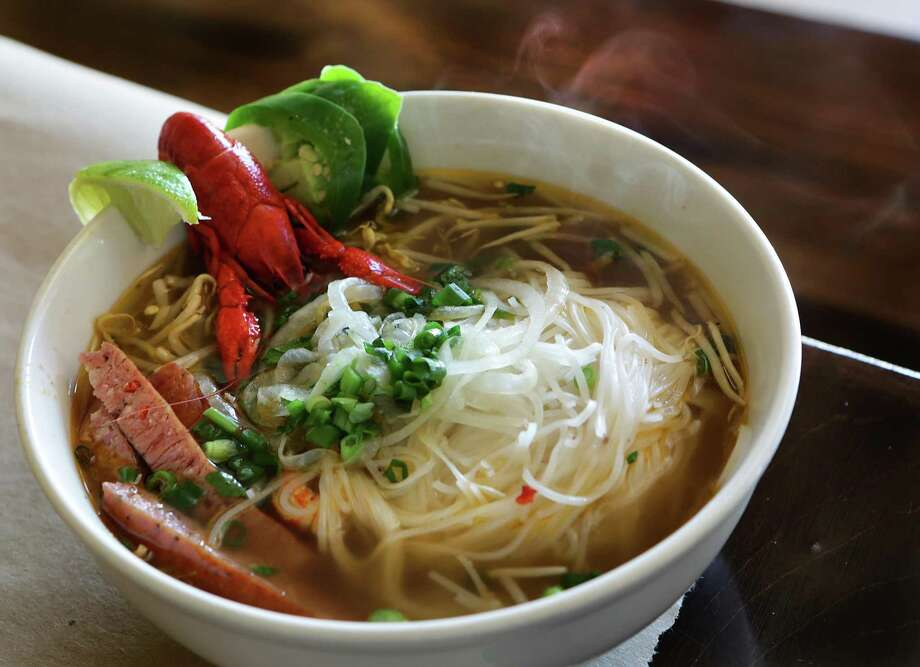 A steaming bowl of Crawfish Pho at LA Crawfish. Photo: Bob Owen /Staff Photographer / San Antonio Express-News