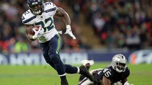 FILE - In this Oct. 14, 2018, file photo, Seattle Seahawks running back Chris Carson (32) runs clear of Oakland Raiders defensive back Dominique Rodgers-Cromartie (45) during the second half of an NFL football game, at Wembley stadium in London. Seattle plays at Detroit on Sunday, Oct. 28.