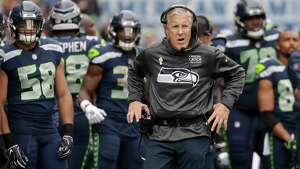 FILE - In this Oct. 7, 2018, file photo, Seattle Seahawks head coach Pete Carroll walks the sideline during the second half of an NFL football game against the Los Angeles Rams, in Seattle. Seattle plays at Detroit on Sunday, Oct. 28.