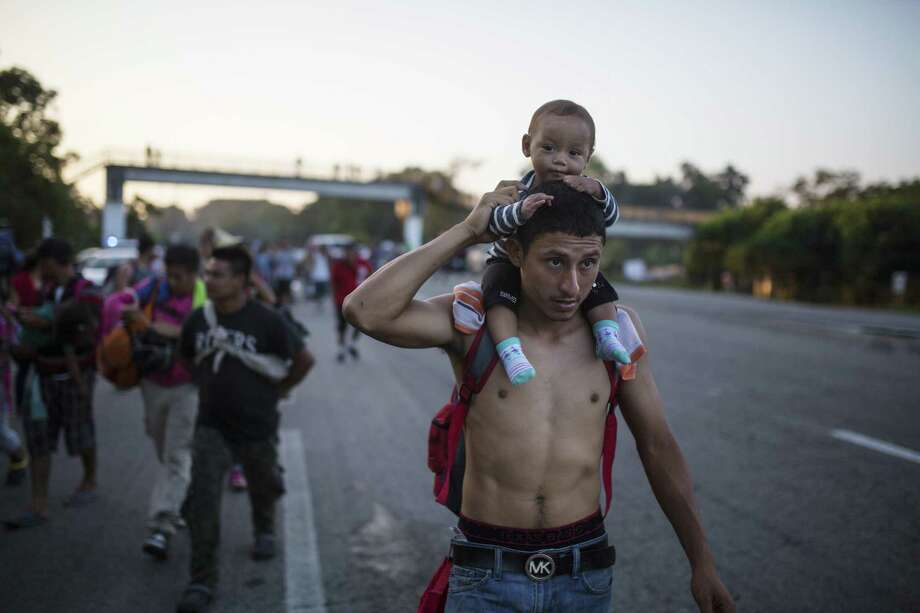 "Central American migrants traveling with a caravan to the U.S. in make their way to Mapastepec, Mexico, on Wednesday. President Donald Trump would have Americans believe about the caravan is full of ""criminals and unknown Middle Easterners."" Photo: Rodrigo Abd /Associated Press / Copyright 2018 The Associated Press. All rights reserved."