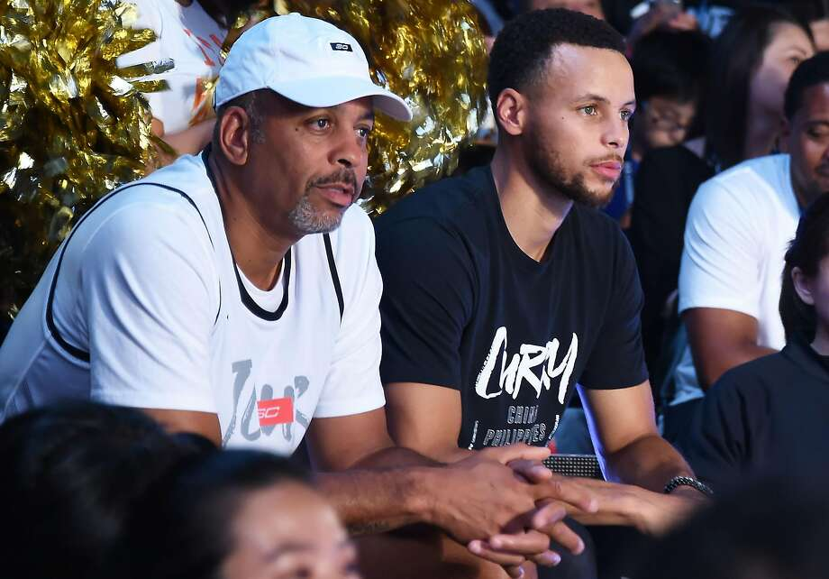 Stephen Curry and Dell Curry attend a 2018 Under Armour fan event in Tokyo. Click ahead to see an assortment of Curry's signature Under Armour shoes through the years. Photo: Jun Sato / WireImage Via Getty Images