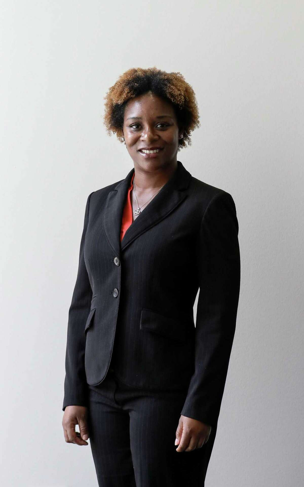 Michelle Moore, Democratic candidate for the 314th Juvenile District Court, poses for a portrait at the Houston Chronicle Wednesday, Oct. 3, 2018, in Houston.