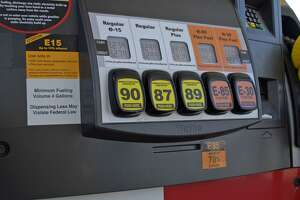 This July 11, 2012, handout photo provided by the Renewable Fuels Association shows a Lawrence, Kansas, fueling station pump with various grades of fuel, including E15, which contains 5 percent more ethanol than the current 10 percent norm sold at most U.S. gas stations. E15 is sold in just 20 stations in six Midwestern states, but could spread to other regions as the Obama administration considers whether to require more ethanol in gasoline; it's cheaper and cleaner but it could damage older cars and motorcycles. The American Petroleum Institute has asked the Supreme Court to block sales of E15. The Court could decide as soon as Monday, June 24, 2013, whether to hear the ethanol case. (AP Photo/Renewable Fuels Association, Robert White)