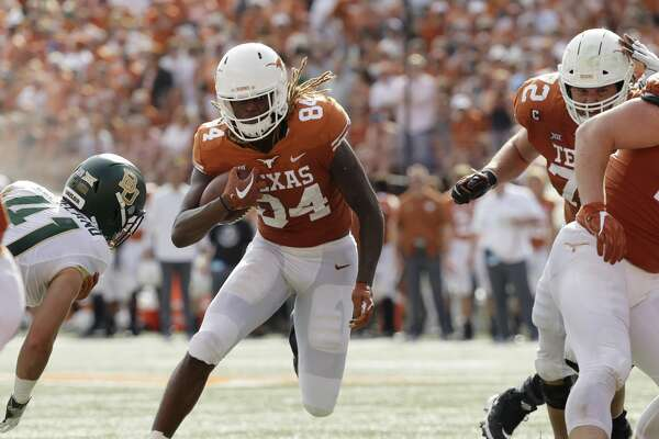 Texas wide receiver Lil'Jordan Humphrey (84) runs for a touchdown against Baylor during the first half on an NCAA college football game, Saturday, Oct. 13, 2018, in Austin, Texas. (AP Photo/Eric Gay)
