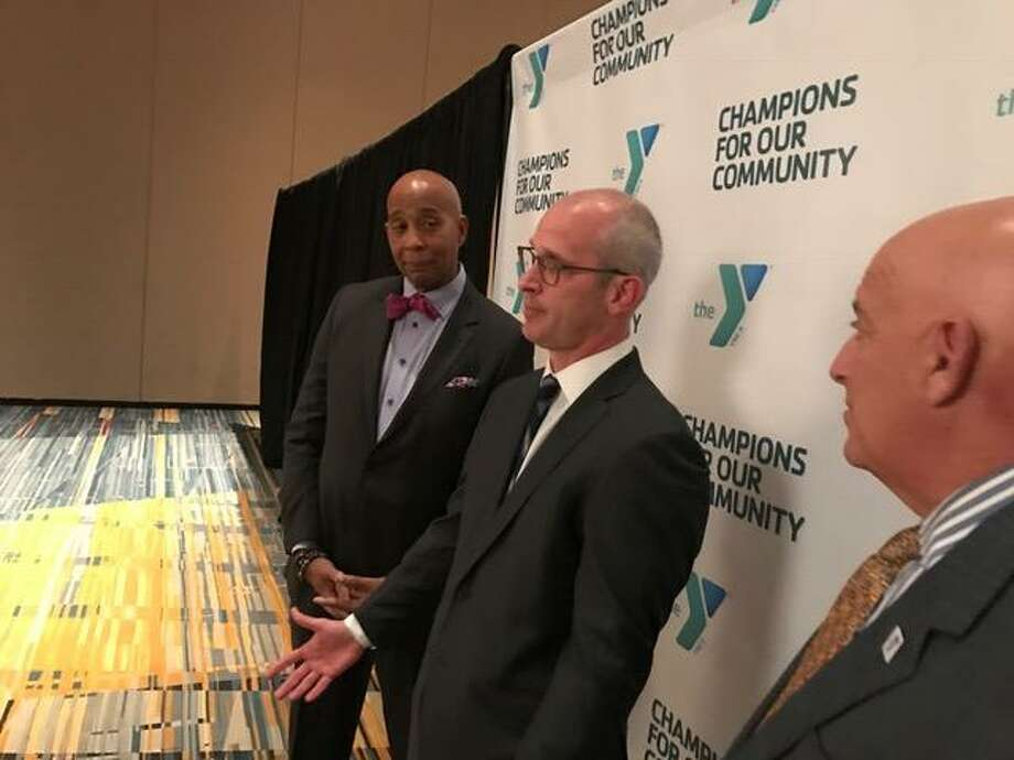 Harold Sparrow (left), president and CEO of the YMCA of Greater Hartford, looks on as Dan Hurley speaks to the media Thursday night. Photo: David Borges / New Haven Register