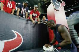 Houston Texans linebacker Whitney Mercilus signs autographs before an NFL football game against the Miami Dolphins at NRG Stadium on Thursday, Oct. 25, 2018, in Houston.