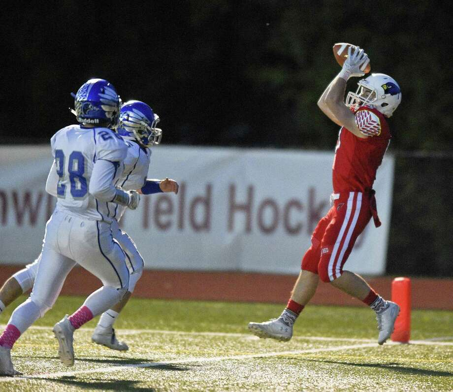 Greenwich's Stephen Bennett (5) makes a touchdown reception against Fairfield Ludlowe during the first half of an FCIAC varsity football game at Cardinal Stadium on Thursday, Oct. 24, 2018 in Greenwich, Connecticut. Photo: Matthew Brown / Hearst Connecticut Media / Stamford Advocate