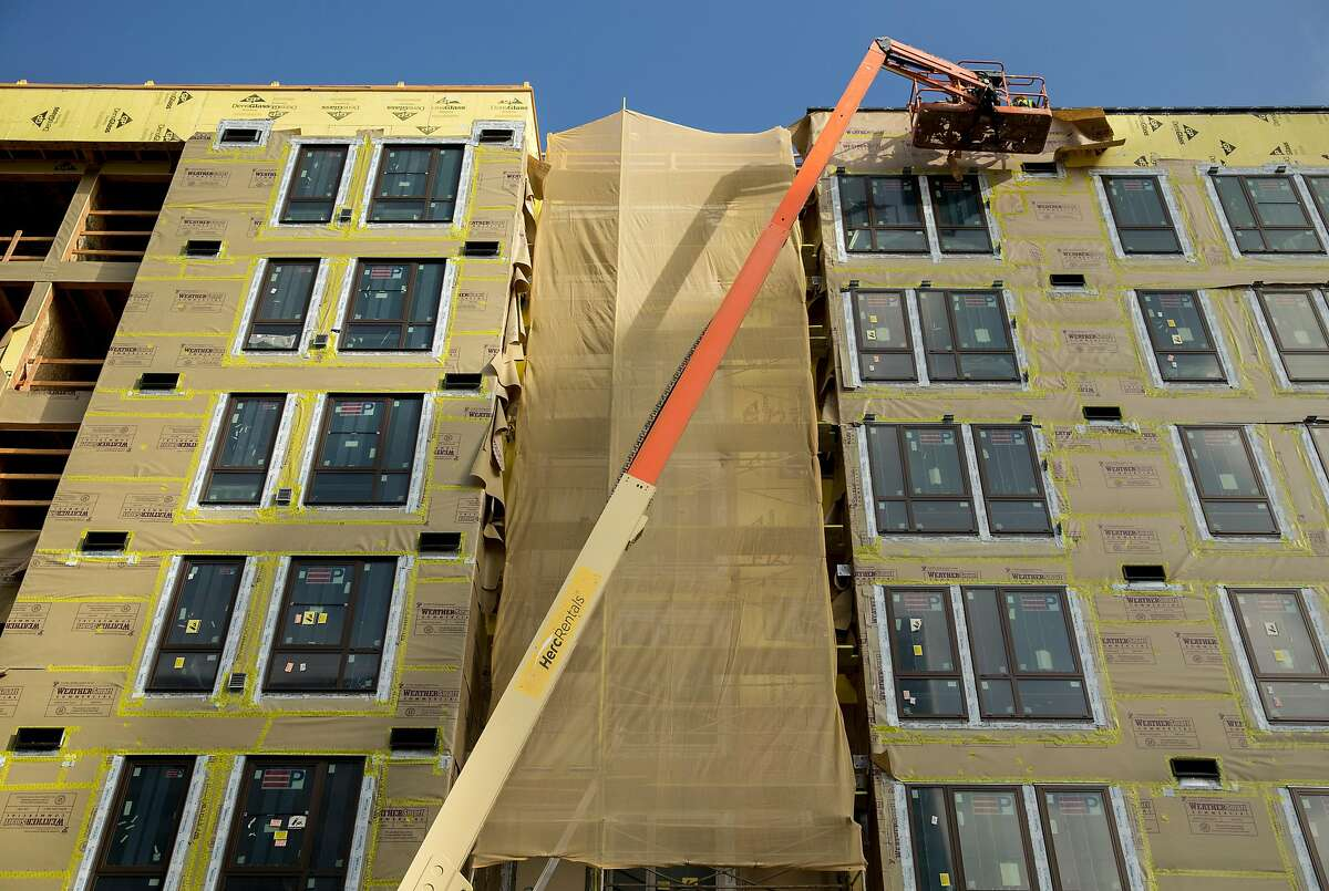 Alta Waverly, a mixed use 196-unit housing development under construction near 23rd and Valdez, is seen under construction following a damaging fire in July 2017 in Oakland, Calif. Thursday, Oct. 25, 2018.