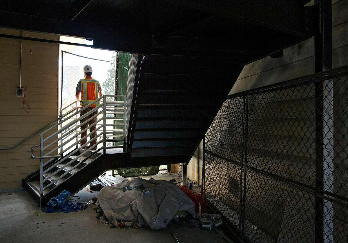 A construction worker stands inside Hollis Oak, a 124-unit housing development under construction along Hollis Street in Oakland, Calif. Thursday, Oct. 25, 2018.