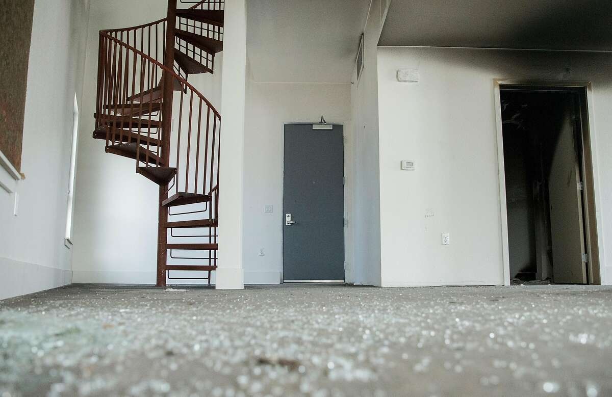 Broken glass and smoke damage are after a break-in occurred and a small fire was set inside a unit of Hollis Oak, a 124-unit housing development under construction along Peralta Avenue in Oakland, Calif. Thursday, Oct. 25, 2018.