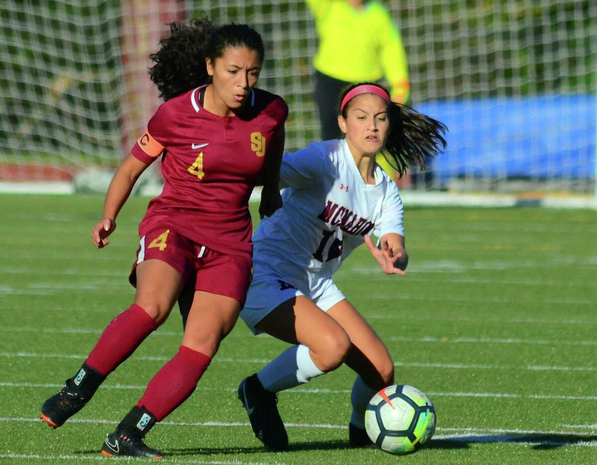 St. Joseph's Jessica Mazo, left, and Brien McMahon's Kailynn Ortiz converge on the ball during girls soccer action in Trumbull, Conn., on Thursday Oct. 25, 2018.
