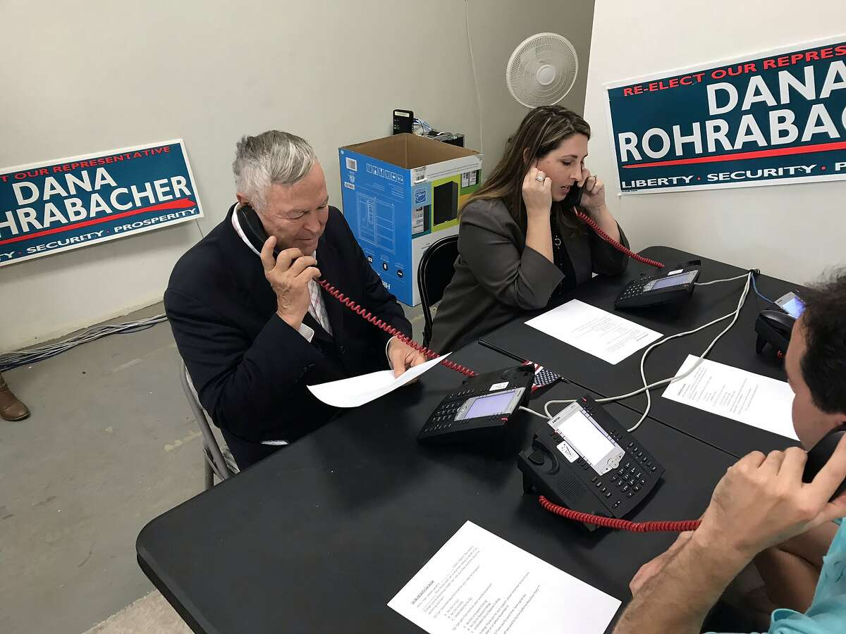 GOP Rep. Dana Rohrabacher and Ronna McDaniel, chairwoman of the Republican National Committee, call voters from a storefront campaign office in Laguna Niguel on October 17, 2018.