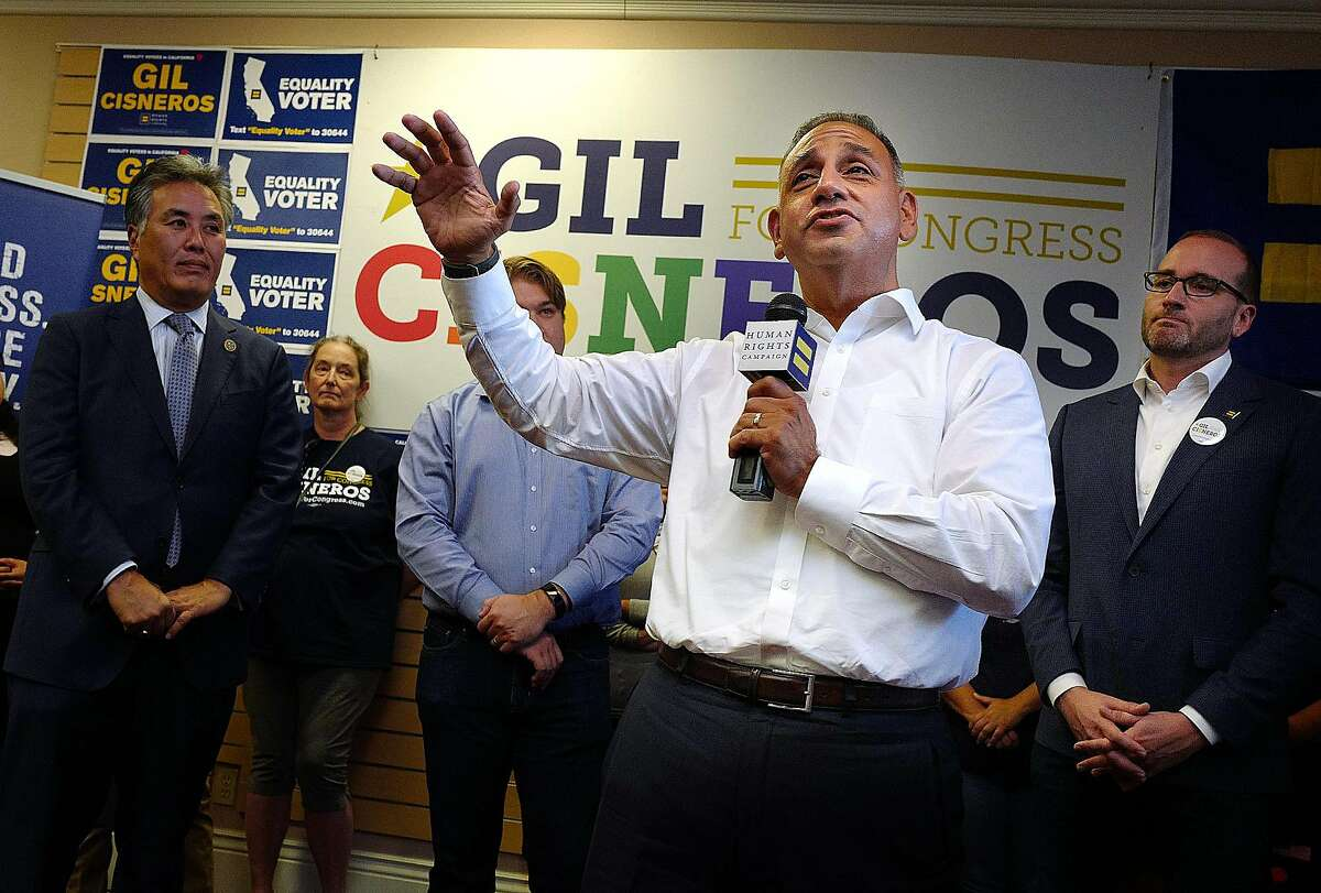 Gil Cisneros speaks to supporters in the 39th Congressional district, which he hopes to win Tuesday, Oct. 16, 2018 in Brea. On his left is Congressman Mark Takamo, Phil Janowicz of Solutions for Congress and on his right is Chad Griffin, President of the Human Rights Campaign. (Photo by Michael Fernandez, Contributing Photographer)