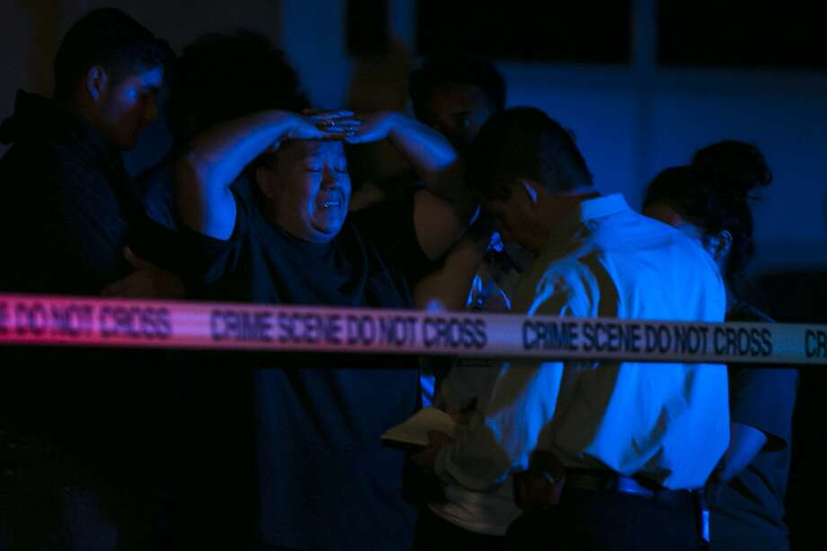 Family members react to information about the shooting on the 4000 block of Mystic Sunrise in San Antonio, Thursday, Oct. 25, 2018. One person has been confirmed dead and two others were taken to the hospital for treatment. Photo: Josie Norris, Staff / San Antonio Express-News / © San Antonio Express-News