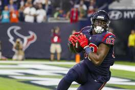 Houston Texans tight end Jordan Thomas (83) pulls in a touchdown pass from Houston Texans quarterback Deshaun Watson (4) to give the Texans the lead during the second quarter of an NFL game at NRG Stadium, Thursday, Oct. 25, 2018, in Houston.