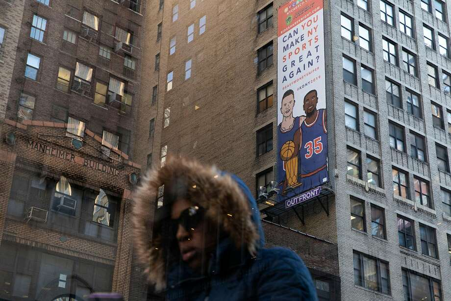 "A billboard depicting Kevin Durant and Kristaps Porzingis in matching blue jerseys, reads ""Can You Make NY Sports Great Again?"" outside of Madison Square Garden in New York, on Thursday, Oct. 25, 2018. Many New York Knicks fans have their hearts set on snagging Durant to be their latest savior. One fan is betting on a billboard to seal the deal. (Gabriella Angotti-Jones/The New York Times) Photo: GABRIELLA ANGOTTI-JONES;Gabriella Angotti-jones / New York Times"