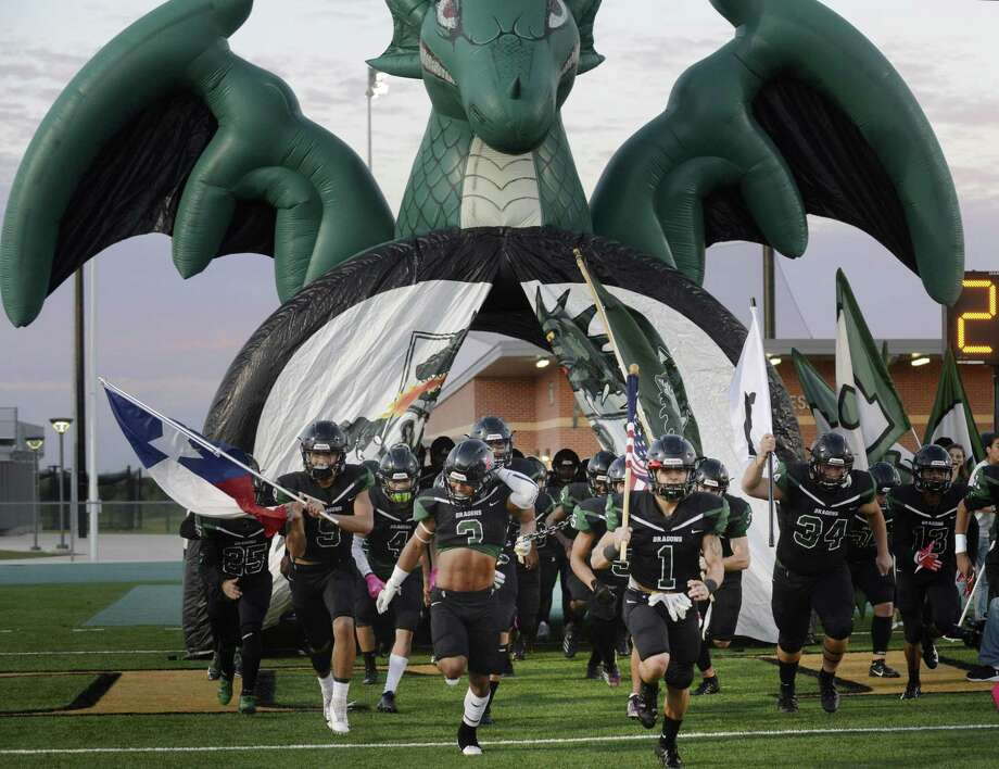 The Southwest Dragons take the field against Harlandale at Southwest Legacy Titan Stadium on Thursday, Oct. 25, 2018. Photo: Billy Calzada, Staff / Staff Photographer / San Antonio Express-News