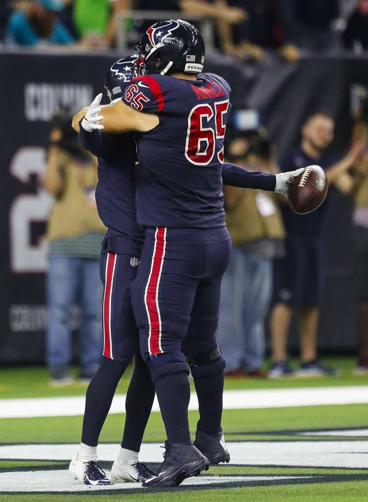 Houston Texans wide receiver Will Fuller (15) is hugged by center Greg Mancz (65) after catching a 73 yard touchdown pass from quarterback Deshaun Watson (4) during the third quarter of an NFL football game at NRG Stadium on Thursday, Oct. 25, 2018, in Houston. Photo: Brett Coomer/Staff Photographer