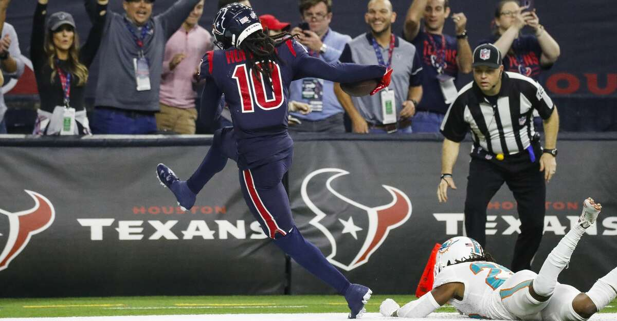 Houston Texans wide receiver DeAndre Hopkins (10) leaps into the endzone past Miami Dolphins cornerback Bobby McCain (28) with a 49 yard touchdown reception during the fourth quarter of an NFL game at NRG Stadium, Thursday, Oct. 25, 2018, in Houston.