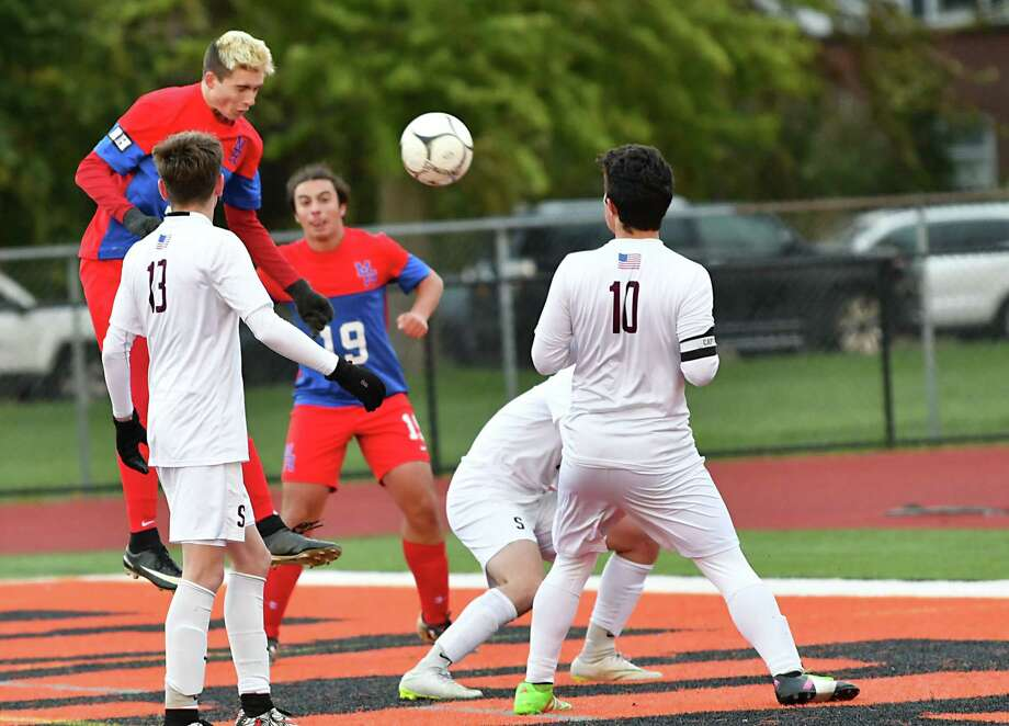 Maple Hill's Seth Roberts, left, heads a corner kicked ball into the net to score during the Class C boys' soccer semifinals against Stillwater at Mohonasen High School on Thursday, Oct. 25, 2018 in Schenectady, N.Y. (Lori Van Buren/Times Union) Photo: Lori Van Buren / 20045244A