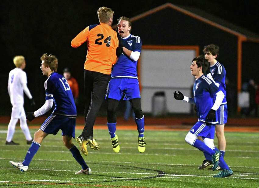 Lake George goalie Mason Flatley, #24, celebrates with Phillip Shambo who just scored in the first half during the Class C boys' soccer semifinals against Mayfield at Mohonasen High School on Thursday, Oct. 25, 2018 in Schenectady, N.Y. (Lori Van Buren/Times Union)