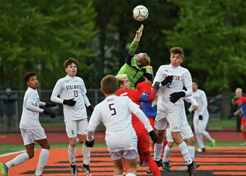 Stillwater goalie Tim Buchal tries to grab a corner kick from Maple Hill during the Class C boys' soccer semifinals at Mohonasen High School on Thursday, Oct. 25, 2018 in Schenectady, N.Y. (Lori Van Buren/Times Union)