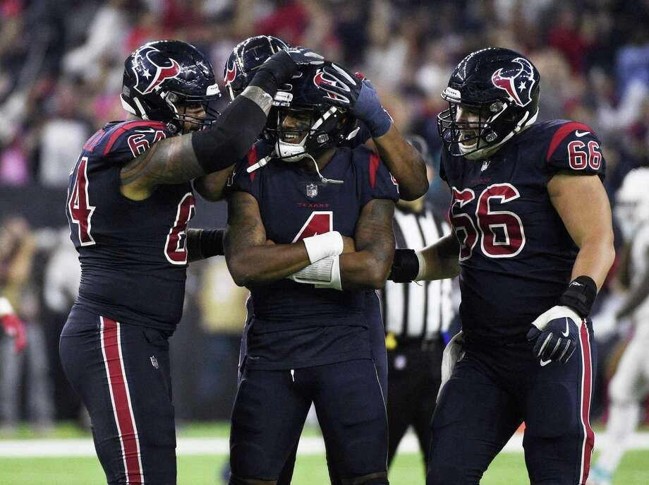Houston Texans quarterback Deshaun Watson (4) celebrates his touchdown pass with teammate during the second half of an NFL football game against the Miami Dolphins, Thursday, Oct. 25, 2018, in Houston. (AP Photo/Eric Christian Smith) Photo: Eric Christian Smith, FRE / Associated Press / Copyright 2018 The Associated Press. All rights reserved.