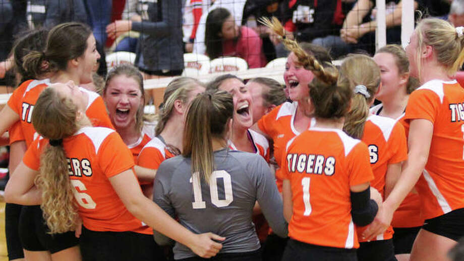 The Greenfield Tigers celebrate their first postseason championship since 2007 after beating Calhoun in three sets Thursday in the title match of the Calhoun Class 1A Sectional in Hardin. Photo: Greg Shashack / The Telegraph
