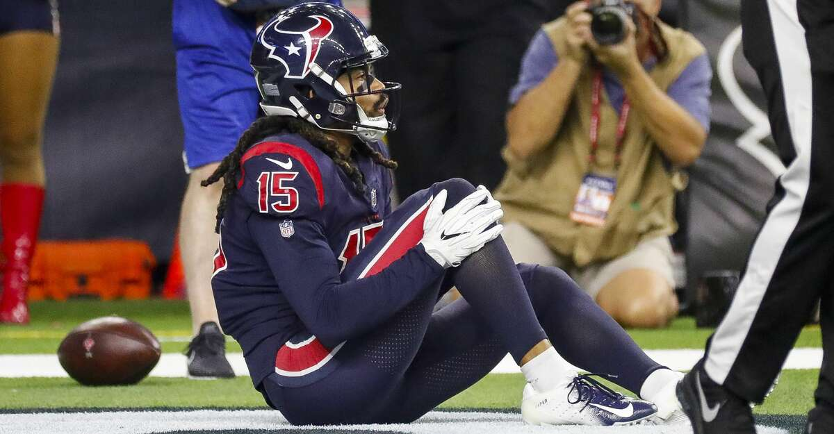 Houston Texans wide receiver Will Fuller (15) grabs his knee after a play in the endzone during the fourth quarter of an NFL game at NRG Stadium, Thursday, Oct. 25, 2018, in Houston.