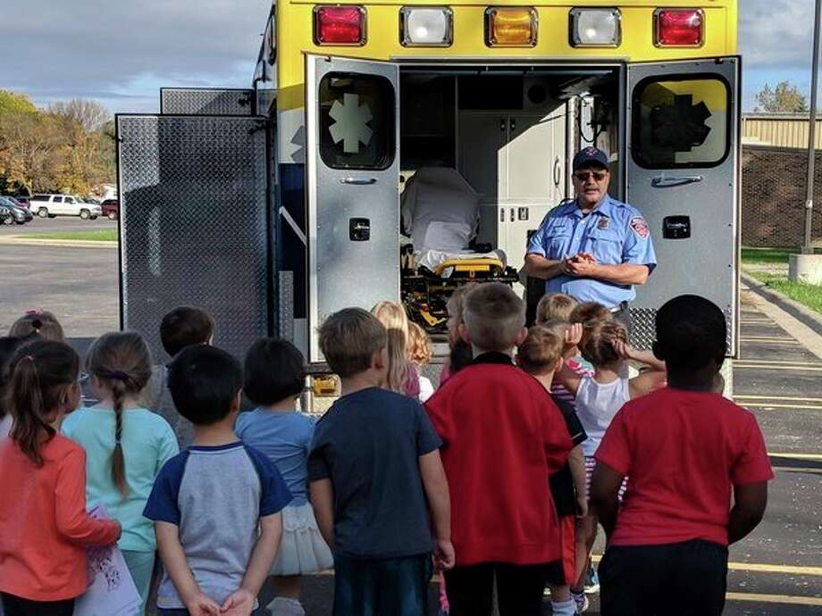A representative fromMidMichigan Medical Center-Emergency Medical Services shows equipment to students. (Photo provided)