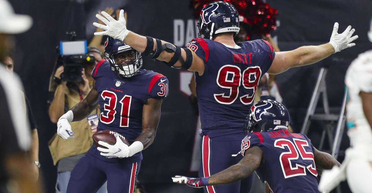 Houston Texans defensive back Natrell Jamerson (31), defensive end J.J. Watt and strong safety Kareem Jackson (25) celebrate a fumble returned for a touchdown that was overturned during the second quarter of an NFL football game at NRG Stadium on Thursday, Oct. 25, 2018, in Houston.