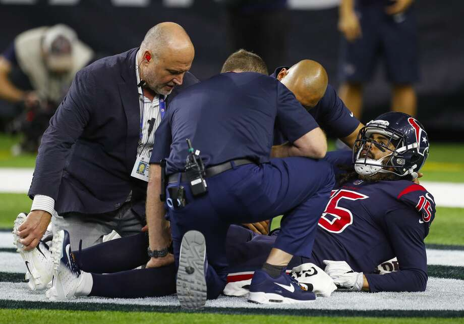 Houston Texans wide receiver Will Fuller (15) is attended to after an injury during the fourth quarter of an NFL football game at NRG Stadium on Thursday, Oct. 25, 2018, in Houston. Photo: Brett Coomer/Staff Photographer