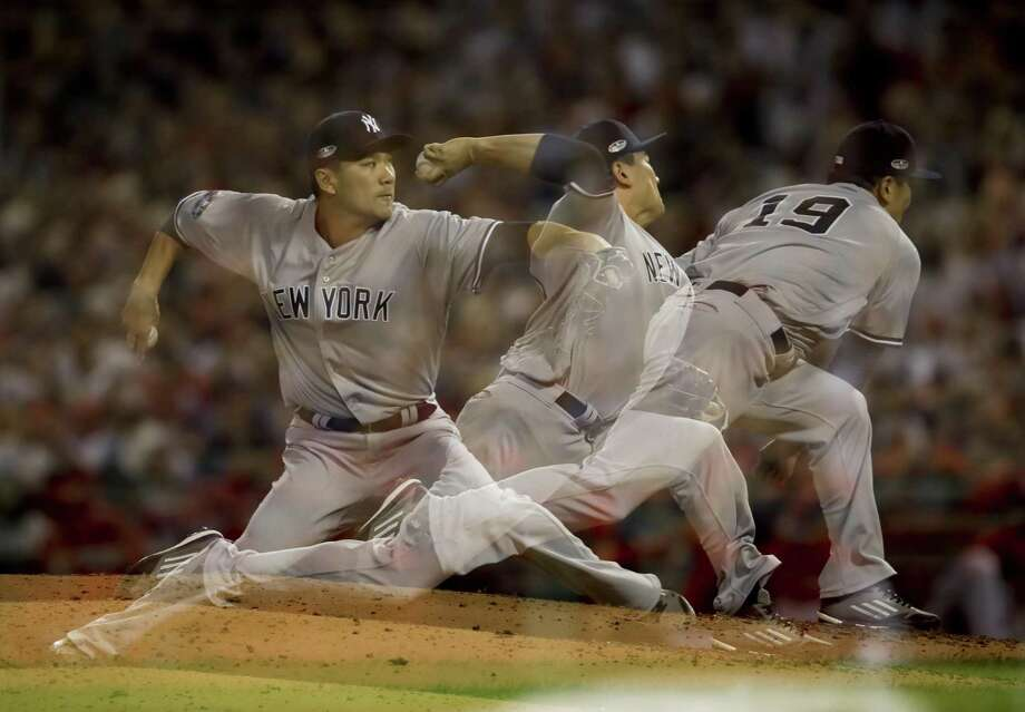 A multiple exposure picture of New York Yankees starting pitcher Masahiro Tanaka throwing against the Boston Red Sox during the fourth inning of Game 2 of a baseball American League Division Series on Oct. 6. Photo: Charles Krupa / Associated Press / Copyright 2018 The Associated Press. All rights reserved