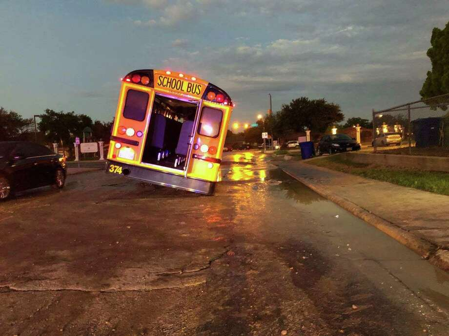 A school bus became partially stuck in a sinkhole Friday morning causing the intersection of Springfield and Gale to close for repairs, the Laredo Police Department said. Photo: Laredo Police Department