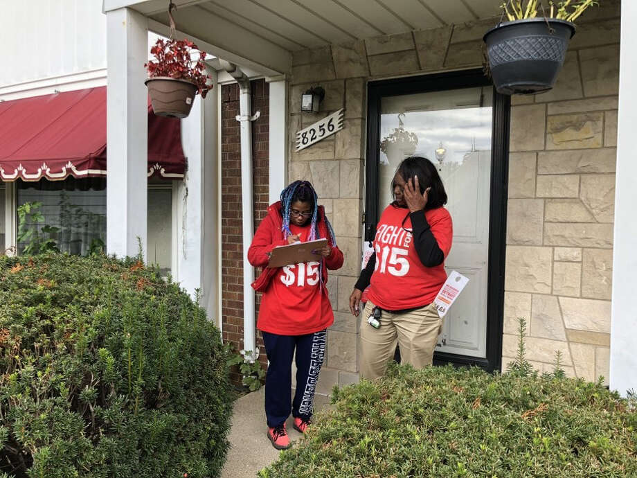Jessica Jackson-Bowie, left, and Deloris Mitchell, right, go door knocking in Detroit last week as part of an effort to persuade African Americans to vote in the midterm elections. Photo: Washington Post Photo By James Hohmann / The Washington Post