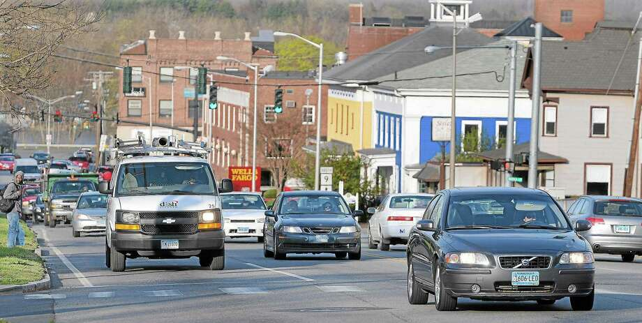 Transportation barriers such as income, age, disability, access to a car, proximity to public transportation, and distance from destinations have the potential to prevent Connecticut residents from getting where they need to go. Shown here is traffic on Washington Street/Route 66 in Middletown. Photo: File Photo / TheMiddletownPress