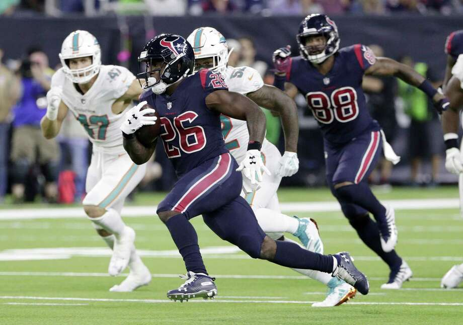 Houston Texans running back Lamar Miller (26) breaks for a long run against the Miami Dolphins during the second half of an NFL football game, Thursday, Oct. 25, 2018, in Houston. (AP Photo/Michael Wyke) Photo: Michael Wyke, FRE / Associated Press / Copyright 2018 The Associated Press. All rights reserved.