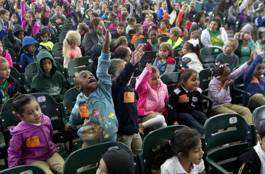 In this file photo, students from Isaacs Elementary raise their hands as they take part in the annual Children's Festival at the Cynthia Woods Mitchell Pavilion, Thursday, Nov. 9, 2017, in The Woodlands. The event is open to the public Nov. 10 from 10 a.m. to 5 p.m. and Nov. 11 from noon to 5 p.m. Photo: Jason Fochtman, Staff Photographer / Houston Chronicle / © 2017 Houston Chronicle