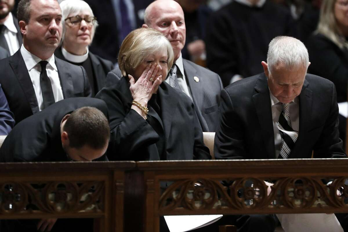 WASHINGTON, DC - OCTOBER 26: Dennis (R) and Judy Shepard (C), parents of Matthew Shepard, arrive for their son Matthew's memorial service at the National Cathedral on October 26, 2018 in Washington, DC. Shepard, a gay man, was murdered twenty years ago is to be interred at the Cathedral. (Photo by Aaron P. Bernstein/Getty Images)