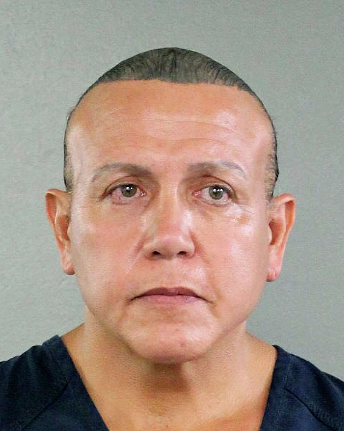 In this undated photo released by the Broward County Sheriff's office, Cesar Sayoc is seen in a booking photo, in Miami. Federal authorities took Sayoc, 56, of Aventura, Fla., into custody Friday, Oct. 26, 2018 in Florida in connection with the mail-bomb scare that earlier widened to 12 suspicious packages, the FBI and Justice Department said. (Broward County Sheriff's Office via AP)
