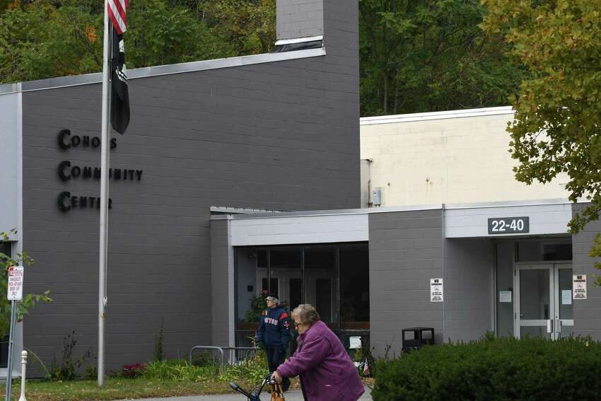 People walk past the Cohoes Community Center on Friday, Oct. 26, 2018, in Albany, N.Y. The center is shutting down. (Will Waldron/Times Union)