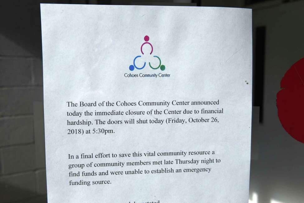 A sign is posted on the door of the Cohoes Community Center announces its closure on Friday, Oct. 26, 2018. (Will Waldron/Times Union)