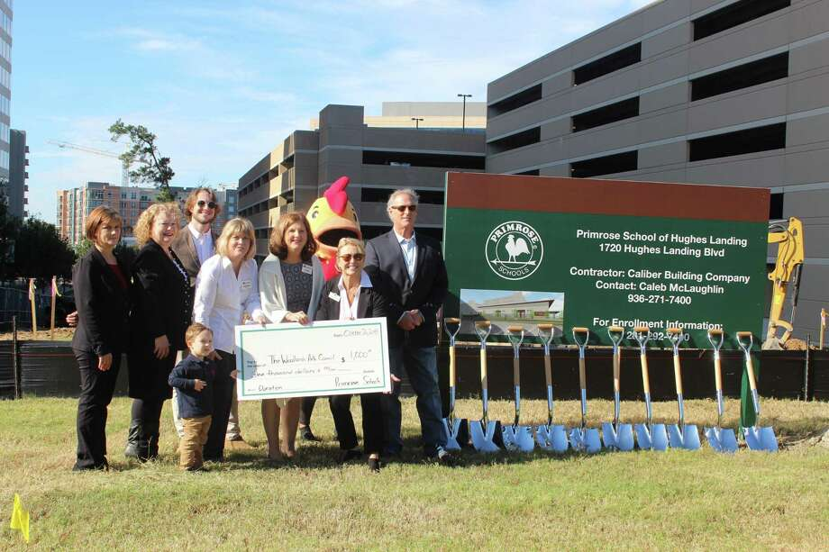 Primrose School owners Arlena and Don McLaughlin (far right) present a donation to The Woodlands Arts Council Development Director Wendy Paynter and President Deb Spiess (center), along with other Primrose School leaders at the campus' groundbreaking ceremony Friday, Oct. 26. Photo: Jane Stuecekmann/The Villager / Jane Stueckemann/The Villager